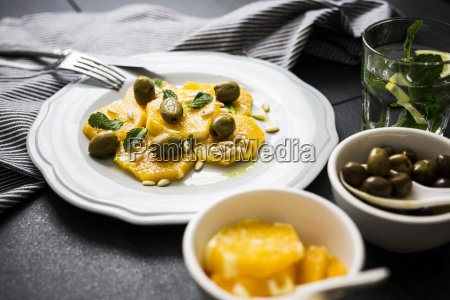 salad with orange slices pine nuts