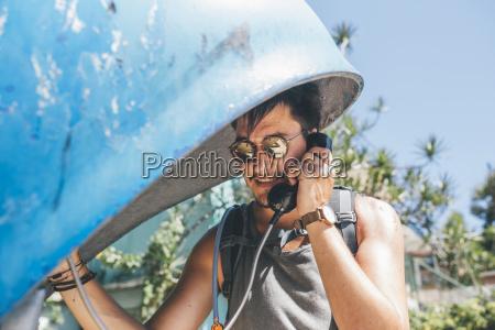 cuba young man amking a call