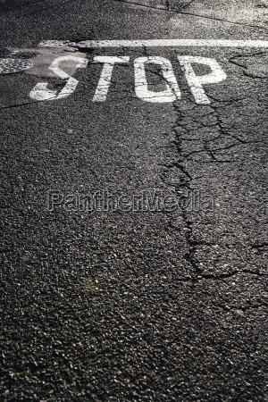 stop sign on tarmac