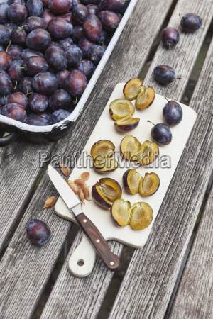fresh plums in casserole and chopped