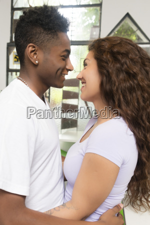 smiling young couple in love embracing