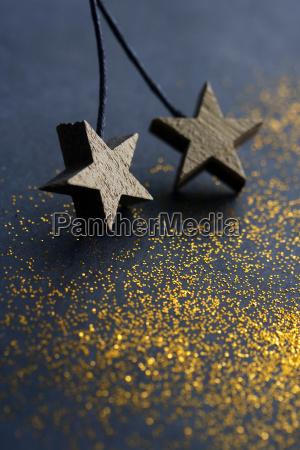 wooden stars on dark background with