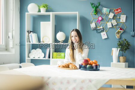 portrait of smiling woman sitting at