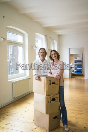smiling mature couple standing in empty