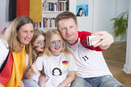 family watching football world cup taking