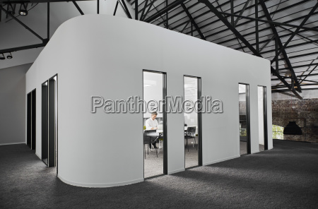 businessman in modern conference room using