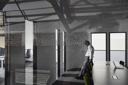 exhausted and frustrated businessman standing in