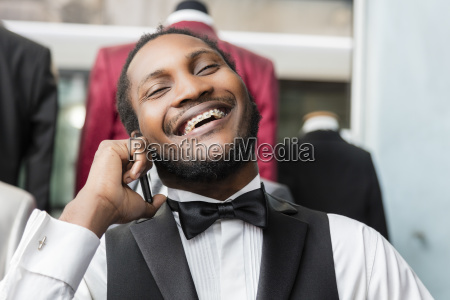 elegant man talking on phone and