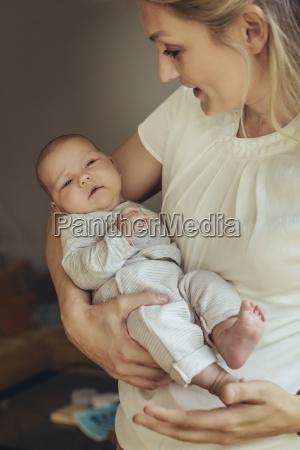 newborn baby being held in mothers