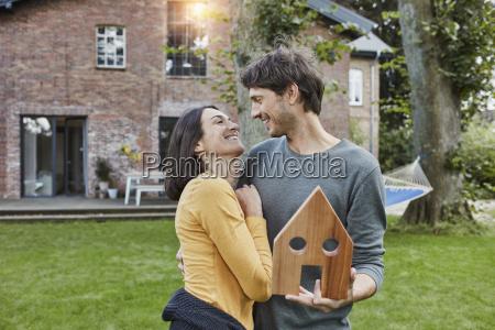 happy couple in garden of their