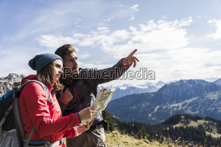 austria tyrol young couple with map