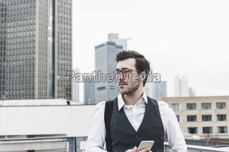 germany frankfurt young businessman with cell