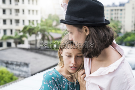 young woman leaning against boyfriend on