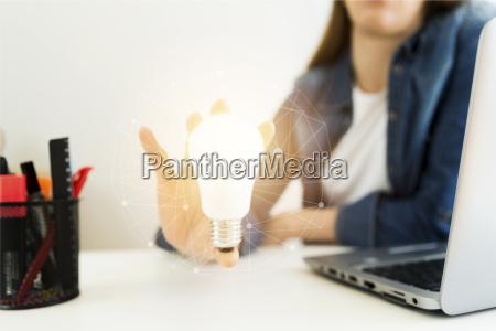 business womens designers hand holding light