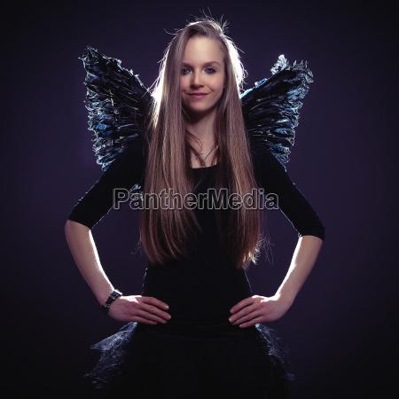cute girl in dark angel costume