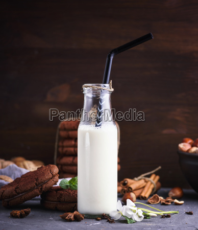 one full glass bottle with milk