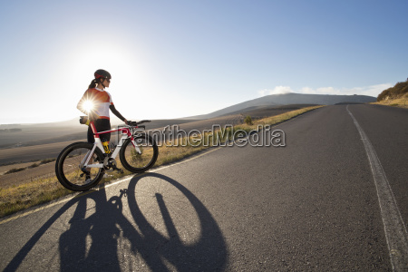 female cyclist with race bicycle on