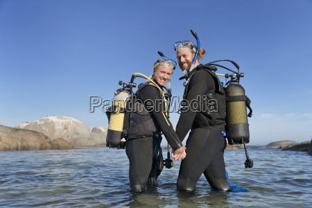 couple smiling to camera and going