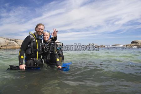 happy scuba diver couple in ocean
