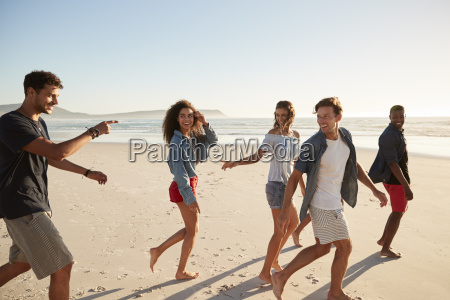 group of friends on vacation walking