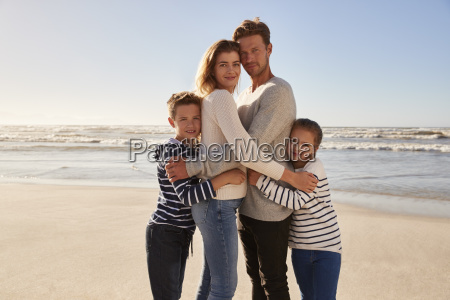 portrait of loving family embracing on