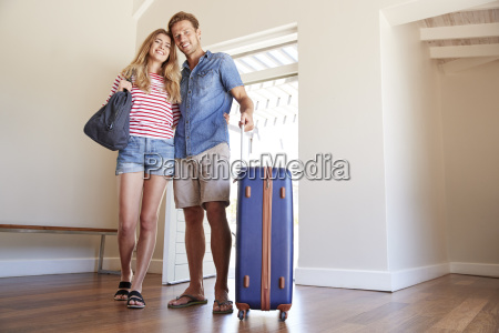 portrait of couple arriving at summer