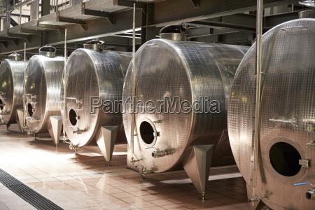 a row of metal vats in