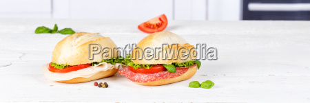 buns baguettes covered with salami and