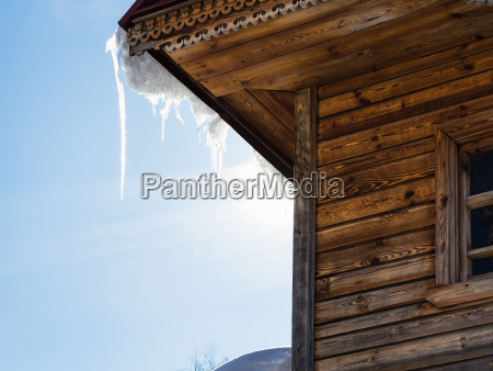 icicle illuminated by sun on roof