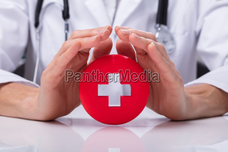 doctor holding first aid sign
