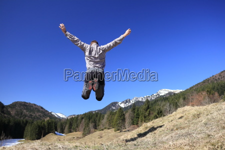 adult man is jumping for joy