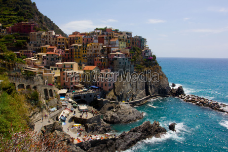 houses on mountain against sea in