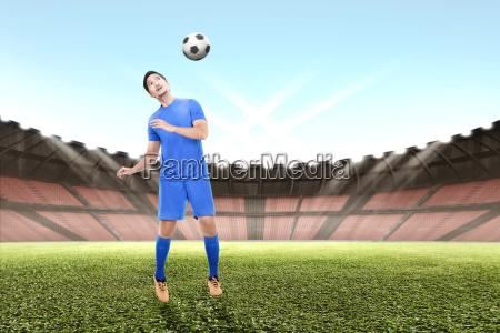young asian soccer player man jump
