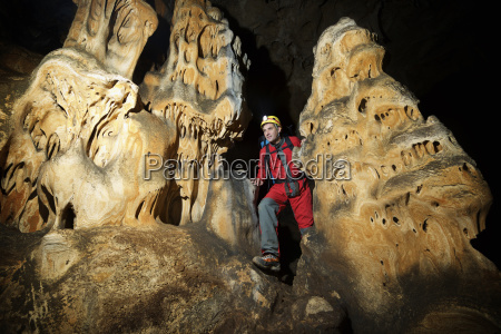 man hiking in cave