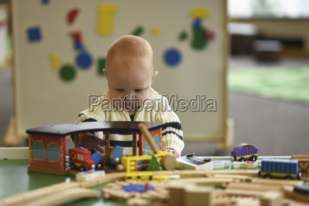 baby boy playing with toys at