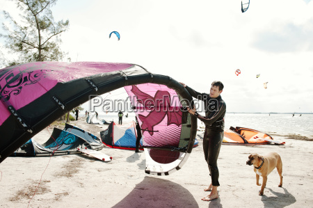 man holding parachute while standing by