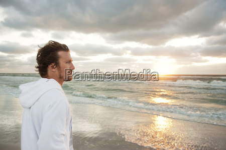 side view of thoughtful man standing