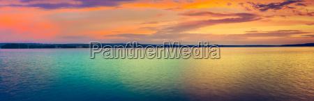 sunset over the lake amazing panorama
