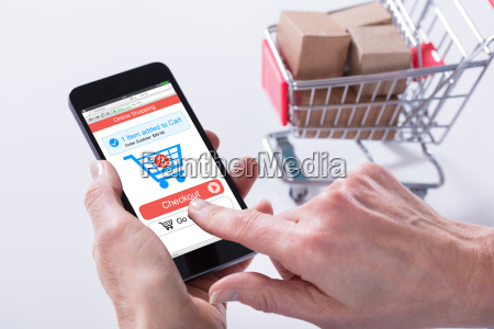person using online shopping application on