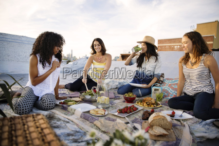 happy friends enjoying food at party