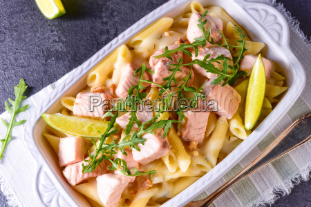 salmon with penne noodle and arugula