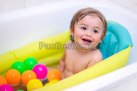 cute baby boy bathing