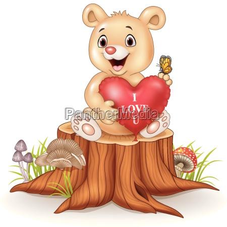 cute bear holding red heart balloons