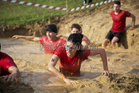 team crossing mud pit during race