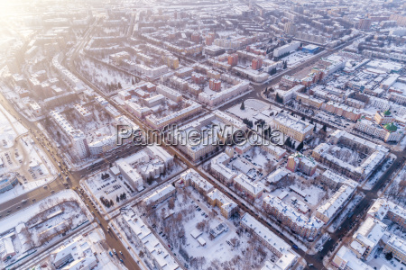 aerial view of snow covered cityscape