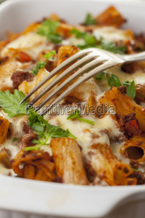 rigatoni noodles with bolognese sauce and