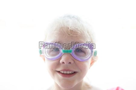 portrait of smiling girl wearing swimming