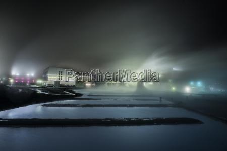 canal at illuminated industry