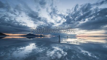 silhouette people standing on bonneville salt