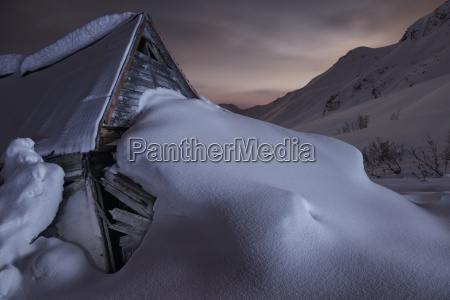 abandoned snow covered gold mine against